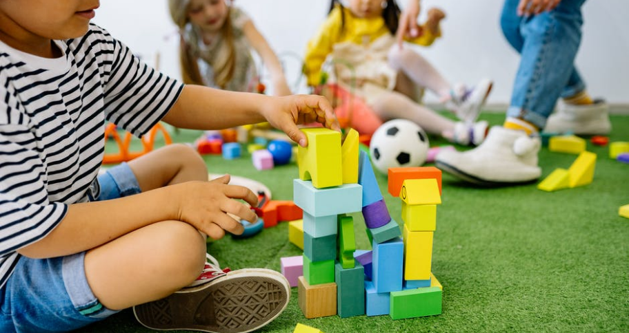 a child playing with toys in preschool