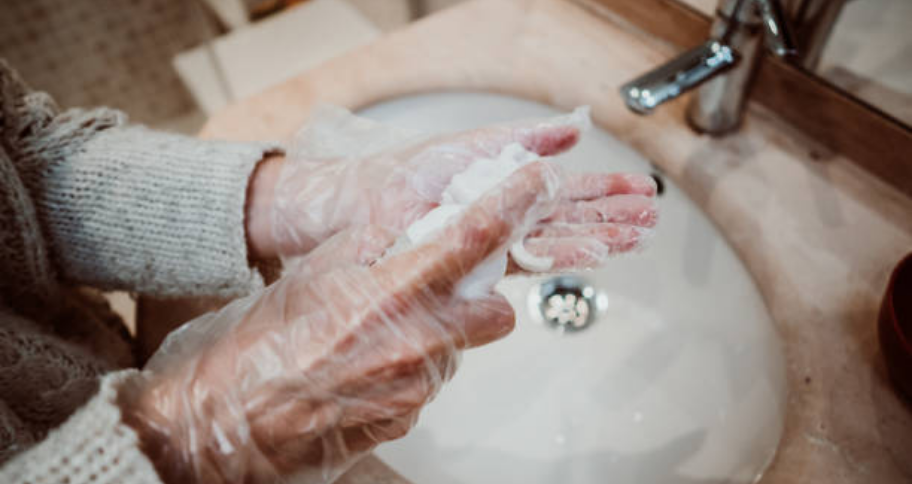 a person using DIY paint stain remover