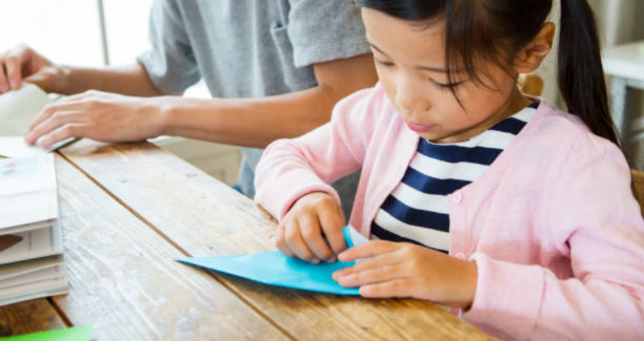 a child doing origami