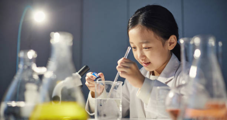 a girl who is doing Science Experiments