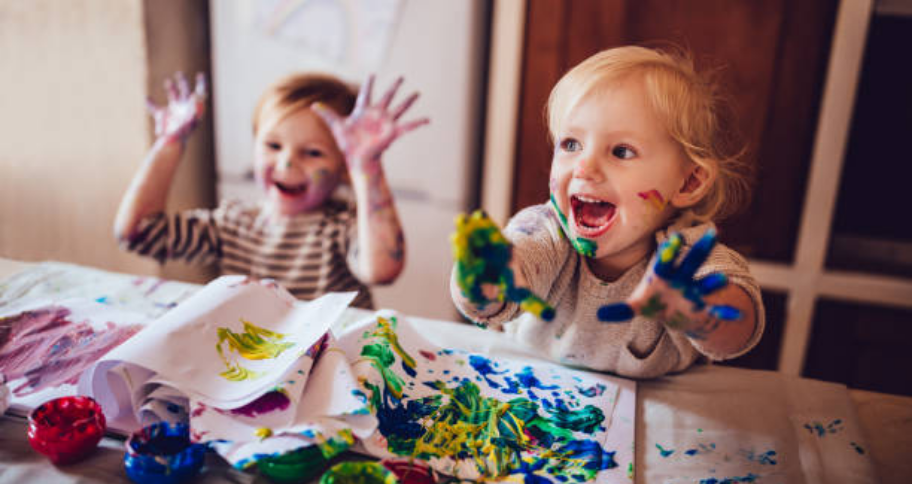 kids painting with their hands
