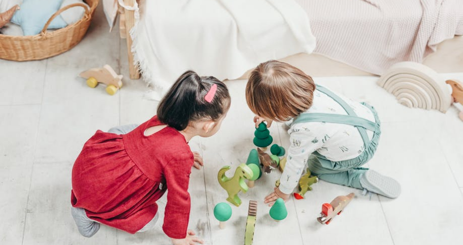 two kids playing with puzzle
